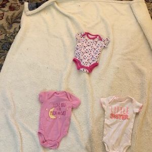Three one pieces infant